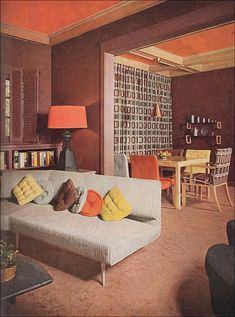 One would be completely forgiven at first glance for thinking that this rust, fox brown and pale mustard yellow home was from the 1970s. It is, in fact, from 1953, many years before a similar palette took the home decor world by storm. Pillows, curtains