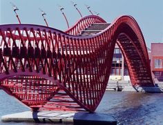 "This red bridge in Amsterdam gets the name ""Python"" from its shape. Built in the bridge's aluminum sea-gulls add decoration to Amsterdam.via realitypod Architecture Amsterdam, Ing Civil, Love Bridge, Poitiers, I Amsterdam, Amsterdam Bicycle, Bridge Design, Pedestrian Bridge, Anaconda"
