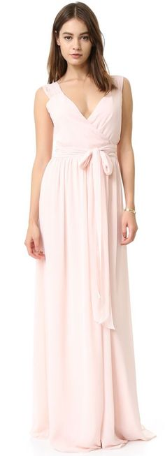 Joanna August Newbury Cap Sleeve Wrap Dress A striking wrap gown composed of flowing chiffon makes a glamorous impression. An attached self-sash ties at the waist, and the sweeping wrap skirt falls easily to the floor. Lined.
