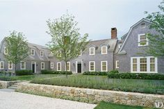 This 8,000-square-foot Shingle Style family summer retreat overlooks the water on Nantucket