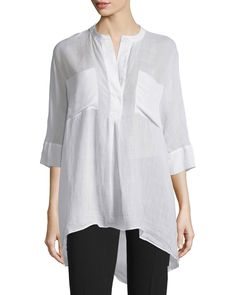 """Joseph """"Heather"""" woven blouse with silk trim. Approx. length: 36""""L down center back. Caftan neckline; hidden button front. Three-quarter sleeves. Patch pockets at front. Relaxed oversized fit. Arched"""