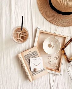 Jewelry OFF! Spreading all of my summer essentials here—iced latte straw hat clear bag cute jewelry and last but not least a good… Jewelry Photography, Book Photography, Lifestyle Photography, Fashion Photography, Product Photography, Beige Aesthetic, Book Aesthetic, Nature Aesthetic, Photo Instagram