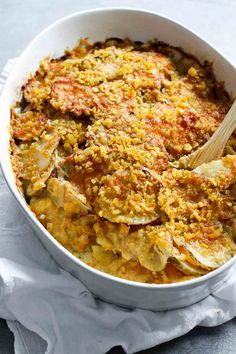The Best Cheesy Potatoes! with sauteed garlic and herbs, two types of potatoes, Gruyère cheese, and a golden crispy topping. SO GOOD. @pinchofyum