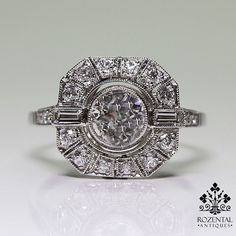 Period: Art deco (1920-1935) Composition: Platinum Stones: - 1 Old mine cut diamond of H-VS2 quality that weighs 0.83ctw. - 18 Old mine cut diamonds of H-VS2 quality that weigh 0.83ctw. Ring size: 7 R