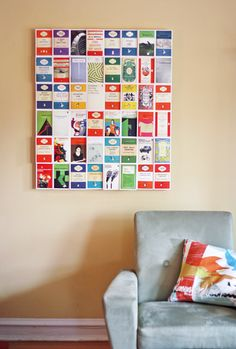 Wall art made using Postcards From Penguin: 100 Book Jackets in One Box. Image from: www.howaboutorange.blogspot.co.uk #beautifulbooks