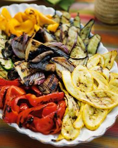How to Grill Delicious Summer Veggies by williams-sonoma: The high heat of the fire brings out the natural sugars in vegetables so they actually retain more of their flavor, vitamins and minerals than they do when cooked in water.   #Grill #Veggies