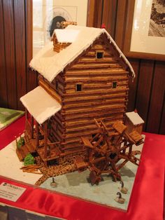 Old Mill Gingerbread House. Looks like an old grain Mill with waterwheel.