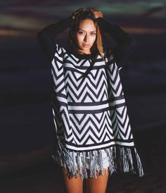 The Ziggy Zigzag Pattern Knit Sweater is made of acrylic & mohair. It has tasseled fringe at the bottom and split sides, drop shoulders, and ribbed sleeves.