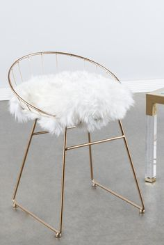 "Materials: Metal, genuine sheepksin (removable), linen ( gray pad) Measurements : 25.5""h x19.5""w x18""d pounds, 8 pounds Seat height: 18""h Colors: gold, white,"