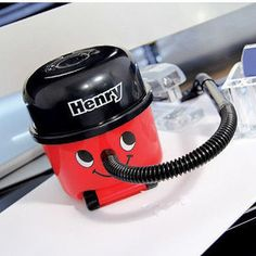 HENRY DESK VACUUM<strong> </strong>Keep your desk in pristine condition with the Henry Desk Vacuum. Designed just like the classic Henry Hoover, this miniature Henry comes with a regular vacuum head and a crevice tool to ensure all the crumbs and dust are sucked up from your desk. #gadget #cool tech gadgets #cool #tech #technology #vacuum #hoover #ipad #monitor #tech