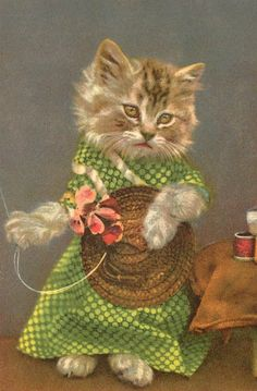 Miss Kitty sews flowers on her hat.   WOW - I had forgotten about this - I had this in a book when I was little!!!!
