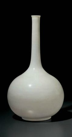 A large white-glazed anhua-decorated bottle vase, China, Qing dynasty, 18th century