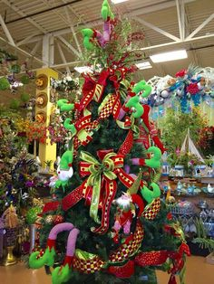 Elf legs whimsical Christmas tree designed by Arcadia Floral & Home Decor