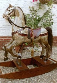 "BRANDY   This rocking horse ""Brandy"" Is covered with 10 layers of paint to get the right colours and realistic surface. This was a commisioned horse: a replica of a young grey pony. Rocking Horse & Art Design Holland"