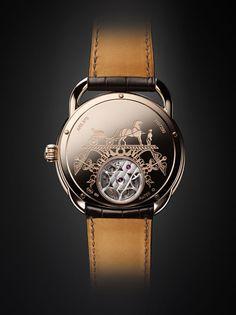 """#HERMES : la #montre """"Arceau Lift"""" tourbillon volant d'Hermès http://www.vogue.fr/joaillerie/le-bijou-du-jour/diaporama/la-montre-arceau-lift-tourbillon-volant-d-hermes/15693#!2"""