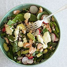 Salad with brown and wild rices, salmon, avocado, asparagus and snow ...