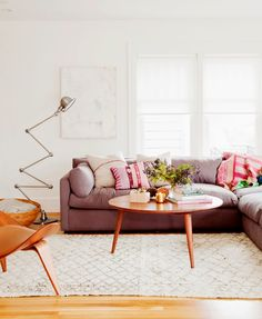 white + wood + textiles + sectional ... the sofa is the perfect share of dusky pink/ plumb