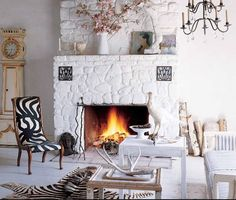 via elle decor.love the white painted stone fireplace. Perfect mantle styling too! White Stone Fireplaces, Painted Stone Fireplace, Stone Fireplace Designs, Paint Fireplace, Rock Fireplaces, White Fireplace, Fireplace Ideas, Stone Mantle, Fireplace Remodel