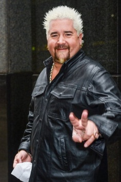 Celebrity chef Guy Fieri in Manhattan on November 13, 2012. His NY restaurant, Guy's American, has earned scathing reviews. (Photo by Ray Tamarra/Getty Images)
