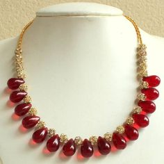 Find wide range of fashion jewellery, imitation, bridal, artificial, beaded and antique jewellery online. Buy imitation jewellery online from designers across India. Call us on [phone] now to resolve your queries. Gold Jewellery Design, Bead Jewellery, Beaded Jewelry, Beaded Necklace, Red Necklace, Jewellery Shops, Antique Jewellery, Jewelry Stores, Emerald Jewelry
