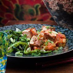 Marinated tofu with tomato and aubergine sauce and garlic greens