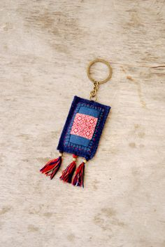 Eco friendly textile keychain. Blue and red textile key chain. Woolen and cotton keychain. Beaded keychain with tassels
