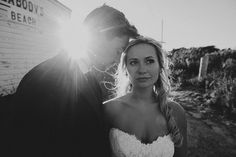 Erica & Jeff. Rhode Island, US.   Beautiful backlight. A gorgeous couple. Sunflare. Framed with a 24mm 1.4 Canon Prime Lens. Processed in VSCO Film with Tri x ++.
