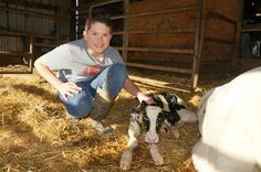 Garrett with a calf he helped deliver