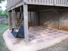 Maybe this is the idea that would be cheaper than doing a poured patio under the deck?? The Patio Project - Southern Hospitality   Southern Hospitality
