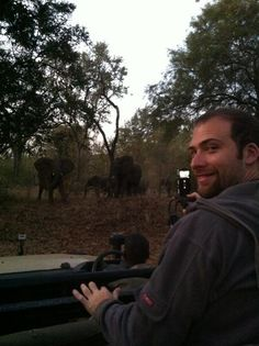 @davidsbeenhere hanging out with elephants in his Ultimate Microfleece Hoodie!