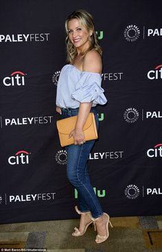 Cutie!Also in attendance was Jessica Capshaw, wearing an on-trend blue-and-white striped off the shoulder blouse with puffy sleeves tucked into skintight blue jeans