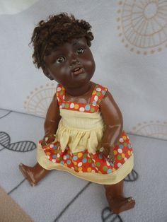 http://www.ebay.de/itm/ALTE-NEGERPUPPE-1935-/371592386156?hash=item5684a1d66c:g:tiMAAOSw6wRXArL2