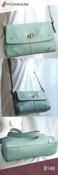 "Coach Leather Crossbody Coach Blue pebbled sturdy well crafted leather Crossbody bag gloriously maintained. Silver tone hardware 2 int slip & 1 zip pockets w/leather toggles. Cotton easy clean interior exterior XL leather slip pocket under front center fold over turn lock closure. This bag is a FIND! For all of you ""Tiffany Blue"" fans out there, ""she"" is for you. She's a beauty & in 9 of 10 shape! She simply needs a new loving home so inquire w/in. 14W 9H 22 Drop. (adjustable). YES! Coach…"