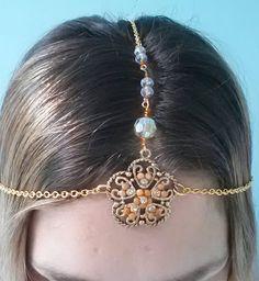 $29  1920s  https://www.etsy.com/listing/106791847/1920s-vamp-head-jewelry