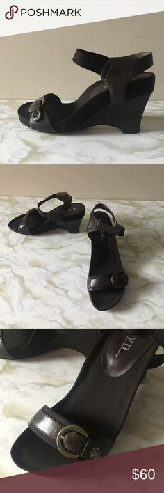Taryn Rose brown leather wedge sandals Like new! Brown wedge sandals from Taryn Rose. Arch support built in. Worn only once. Excellent used condition. Box included. Taryn Rose Shoes Wedges