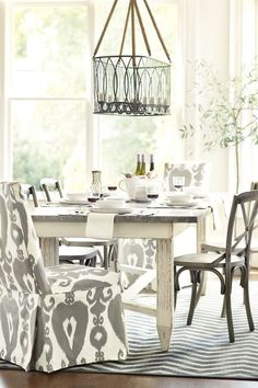 Love the Fashion Chair mixed with simple chairs. Gray and White Dining Room from Ballard Designs Dinning Room Tables, Wooden Dining Tables, Dining Area, Kitchen Dining, Rustic Table, Dining Rooms, Vintage Table, Dining Chairs, Arm Chairs