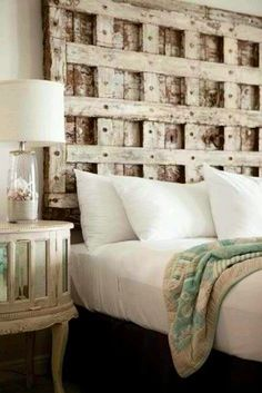 Pallet wood pieces form a unique raised and recessed square pattern on this headboard