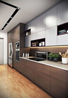 Elegant Straight Kitchen Cabinets Design With Wooden Motifs On The Bottom Cupboard And Plain Gray On The Top Using A Cooktop And Decorated With Beautiful Little Plants Kitchen Design Kitchen Cabinets Design Kitchen Lighting Design, Luxury Kitchen Design, Design Your Kitchen, Contemporary Kitchen Design, Luxury Kitchens, Interior Design Kitchen, Modern Contemporary, Straight Kitchen, Kitchen Cupboard Designs
