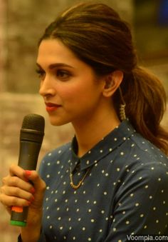 Natural beauty Deepika Padukone wearing a blue Bodice shirt - styled by Shaleena Nathahi, makeup by Puneet B Saini and hairstyle by Gabriel Georgiou. via Voompla.com