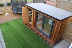Garden office with hidden storage shed built by garden fortress , surrey modern study/office by garden fortress modern Gym Shed, Shed Office, Backyard Office, Outdoor Office, Backyard Studio, Garden Studio, Outdoor Rooms, Garden Shed Gym Ideas, Small Garden Office Shed