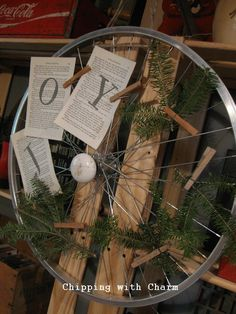 "Chipping with Charm: Bike Rim Wreath, use ""Snow"" or ""Winter"" for words, add paper snowflakes"
