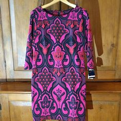 """Just Taylor Dress Beautifully patterend dress in vibrant bold colors. Perfect for that spring wedding, graduation, to lively up your work day or any time you want to make a statement!  Darts in the chest and back areas make this dress fit nicely  New never worn-with tag 10P 33"""" Long 97% Polyester 3% Spandex Just Taylor Dresses"""