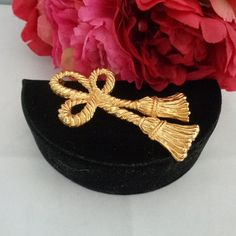 20% off Coupon Code 442016  Goldtone Bow Brooch that Measures 3 inches long. We are having a sale in our store at www.CCCsVintageJewelry.com and there are over 200 items that are eligible for 20% off. All of the items in the store which is more than 600 are getting free shipping. This brooch is in the shape of a bow and is a copy of one made by Givenchy. The only difference is that this one is not stamped on the back Givenchy, The price before your discounts using the coupon code 442016 is…