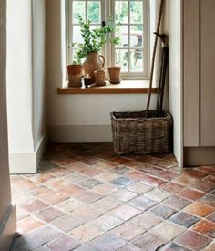 Antique burgundy terracotta tiles from Artisans of Devizes. Rustic tiles look are a great welcome to a country home. Porch Flooring, Brick Flooring, Kitchen Flooring, Floors Of Stone, Stone Kitchen Floor, Brick Tile Floor, Flooring Ideas, Tiled Hallway, Tile Entryway