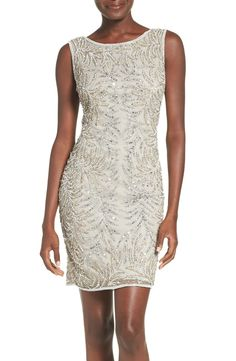 Pearly beads and icy sparkles pattern this airy cocktail sheath dress for a glamorous look.