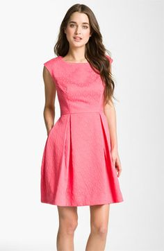 This is cute!  Easy to wear again-not sure about the color.  Not pastel but def not fushia :)