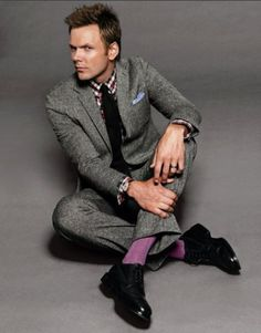 Joel McHale wearing purple socks. So much to love about this!