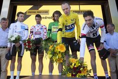 Britain's Adam Yates, , wearing the best young rider's white jersey, Belgium's Thomas de Gendt, wearing the best climber's dotted jersey, Peter Sagan of Slovakia, wearing the best sprinter's green jersey, Britain's Chris Froome, wearing the overall leader's yellow jersey, and Stage winner Netherlands' Tom Dumoulin lay flowers after observing a minute of silence to commemorate the victims of the Nice truck attack on the podium the thirteenth stage of the Tour de France cycling race, an…