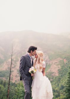 The braids, the flowers, the dress. So lovely. Lauren   Zach Wedding
