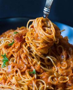 Tomato Cream Pasta Can't Be Beat for Flavor  Ingredients       	1 tablespoon olive oil   	1 small onion, diced   	2 garlic cloves, minced   	1/2 teaspoon dried basil   	1/4 to 1/2 teaspoon crushed red pepper flakes   	1 (24-ounce) jar